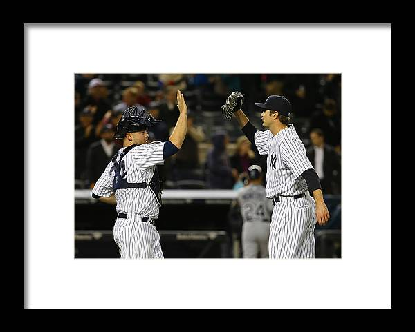Brian Mccann Framed Print featuring the photograph Tampa Bay Rays v New York Yankees by Al Bello