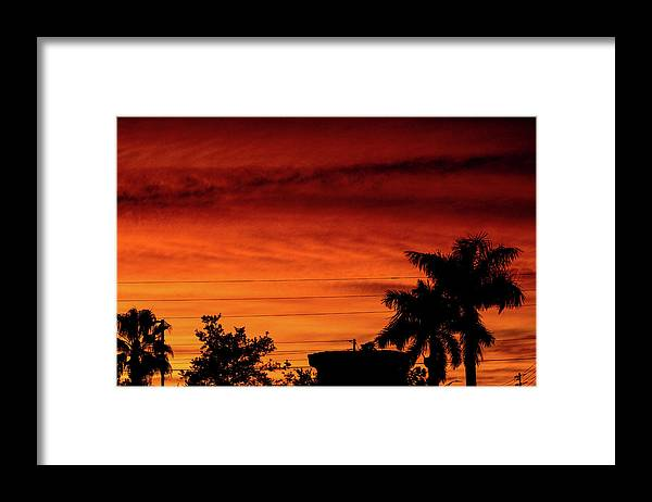 Sunset Framed Print featuring the photograph The Fire sky by Daniel Cornell