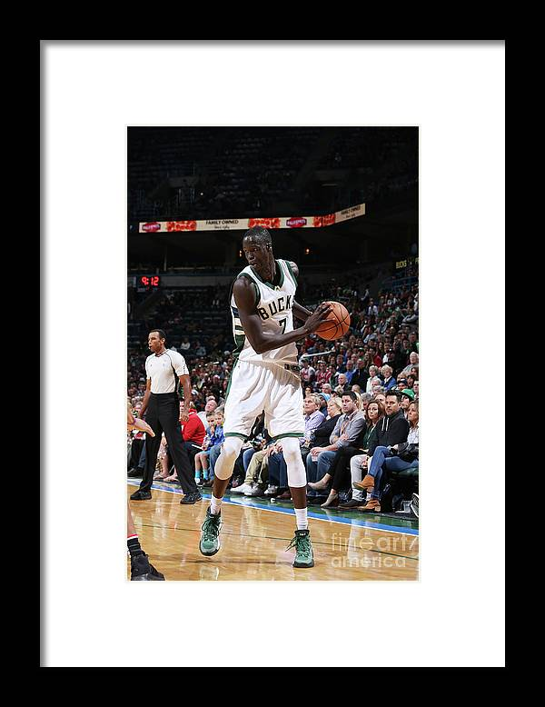 Nba Pro Basketball Framed Print featuring the photograph Thon Maker by Gary Dineen