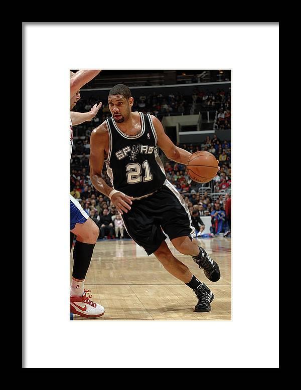 Nba Pro Basketball Framed Print featuring the photograph Tim Duncan and Chris Kaman by Noah Graham
