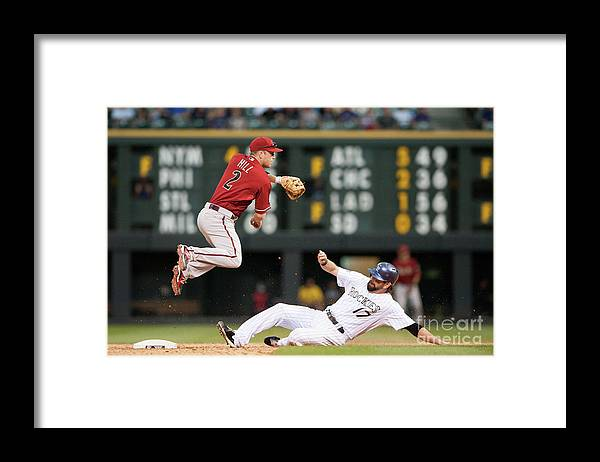 Double Play Framed Print featuring the photograph Todd Helton and Aaron Hill by Dustin Bradford