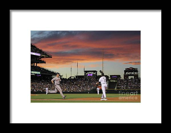 Todd Helton Framed Print featuring the photograph Todd Helton And Buster Posey by Doug Pensinger
