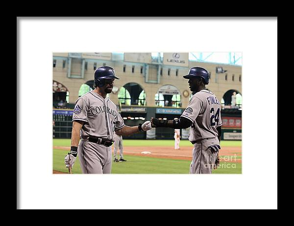 American League Baseball Framed Print featuring the photograph Todd Helton and Dexter Fowler by Scott Halleran
