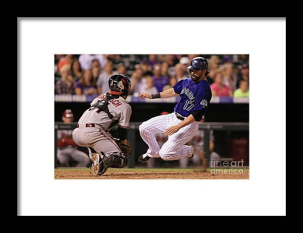 Baseball Catcher Framed Print featuring the photograph Todd Helton and Jordan Pacheco by Doug Pensinger