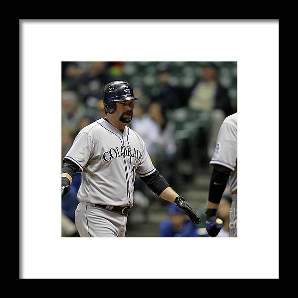 People Framed Print featuring the photograph Todd Helton and Michael Cuddyer by Mike Mcginnis