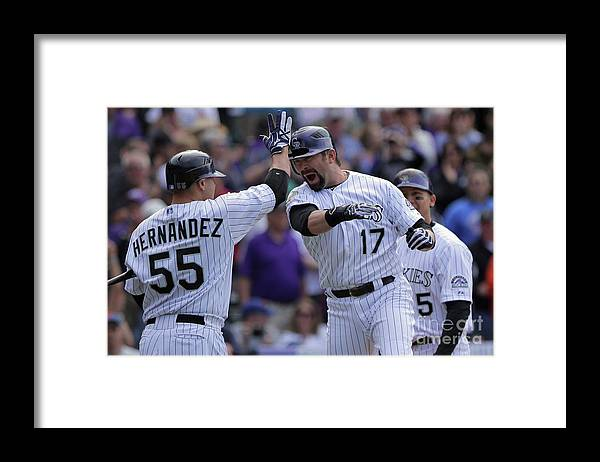 Relief Pitcher Framed Print featuring the photograph Todd Helton and Ramon Hernandez by Doug Pensinger