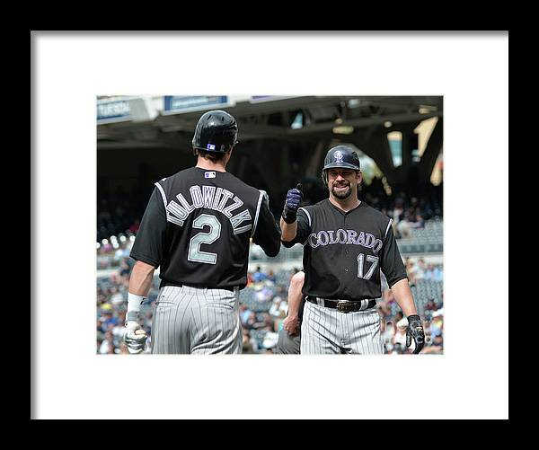People Framed Print featuring the photograph Todd Helton and Troy Tulowitzki by Denis Poroy