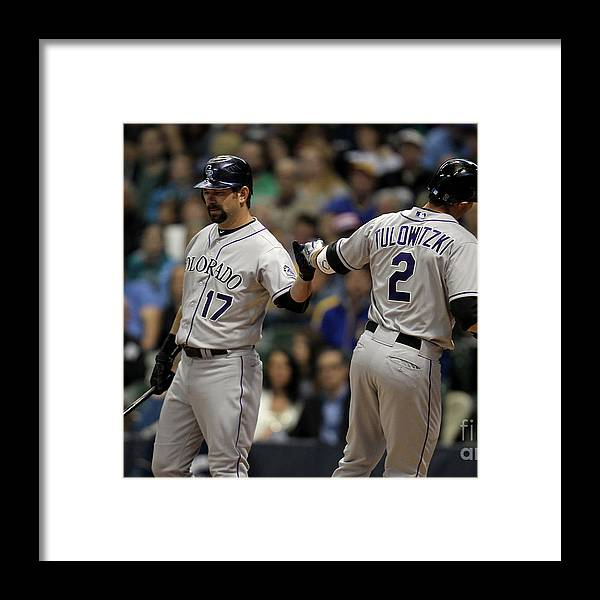People Framed Print featuring the photograph Todd Helton and Troy Tulowitzki by Mike Mcginnis
