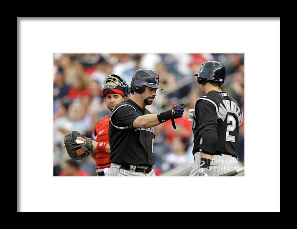 People Framed Print featuring the photograph Todd Helton and Troy Tulowitzki by Rob Carr