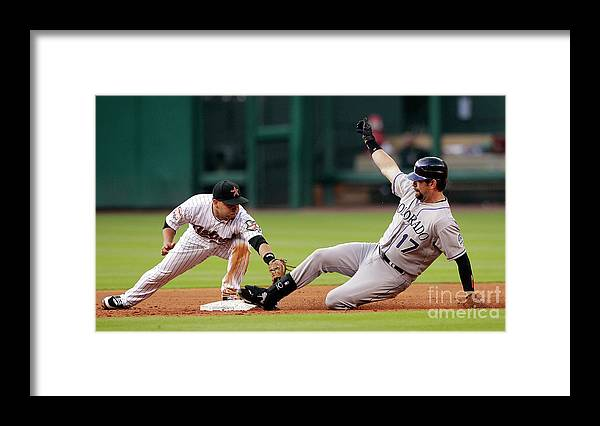 Stretching Framed Print featuring the photograph Todd Helton by Bob Levey