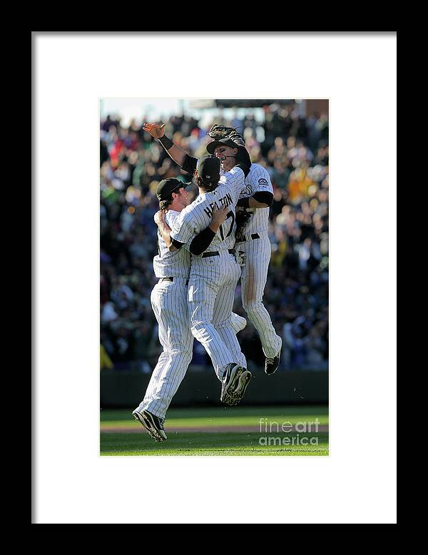 Celebration Framed Print featuring the photograph Todd Helton, Ian Stewart, and Troy Tulowitzki by Doug Pensinger