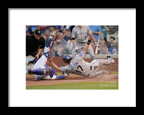 Second Inning Framed Print featuring the photograph Todd Helton, Josh Rutledge, and Welington Castillo by Brian Kersey