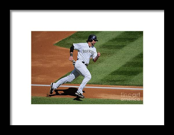 Scoring Framed Print featuring the photograph Todd Helton, Manny Parra, And Garrett Atkins by Doug Pensinger
