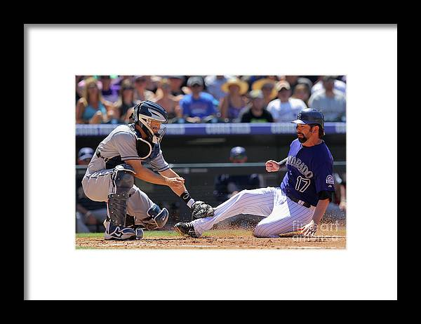 Second Inning Framed Print featuring the photograph Todd Helton, Nick Hundley, and Jonathan Herrera by Doug Pensinger