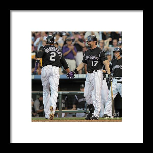 People Framed Print featuring the photograph Todd Helton, Troy Tulowitzki, and Anibal Sanchez by Doug Pensinger