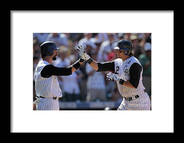 People Framed Print featuring the photograph Todd Helton, Troy Tulowitzki, And Bill Bray by Doug Pensinger