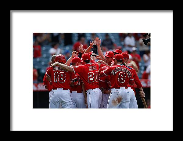People Framed Print featuring the photograph Tom Wilhelmsen and Kole Calhoun by Joe Scarnici