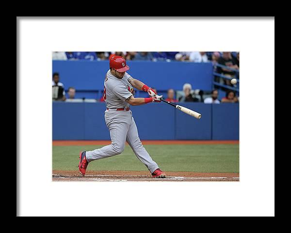 St. Louis Cardinals Framed Print featuring the photograph Tony Cruz by Tom Szczerbowski