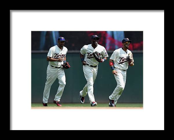People Framed Print featuring the photograph Torii Hunter, Aaron Hicks, and Eddie Rosario by Hannah Foslien