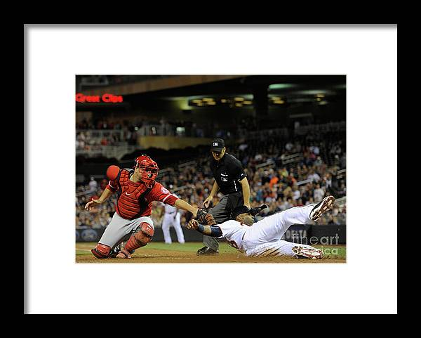 People Framed Print featuring the photograph Torii Hunter and Chris Iannetta by Hannah Foslien