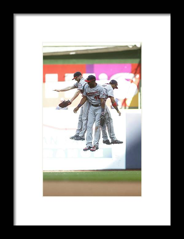 People Framed Print featuring the photograph Torii Hunter and Eduardo Escobar by Mike Mcginnis