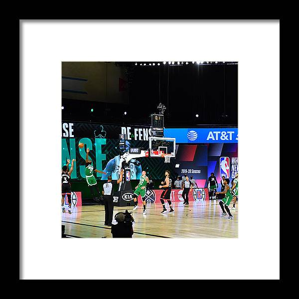 Framed Print featuring the photograph Toronto Raptors v Boston Celtics - Game Three by Jesse D. Garrabrant