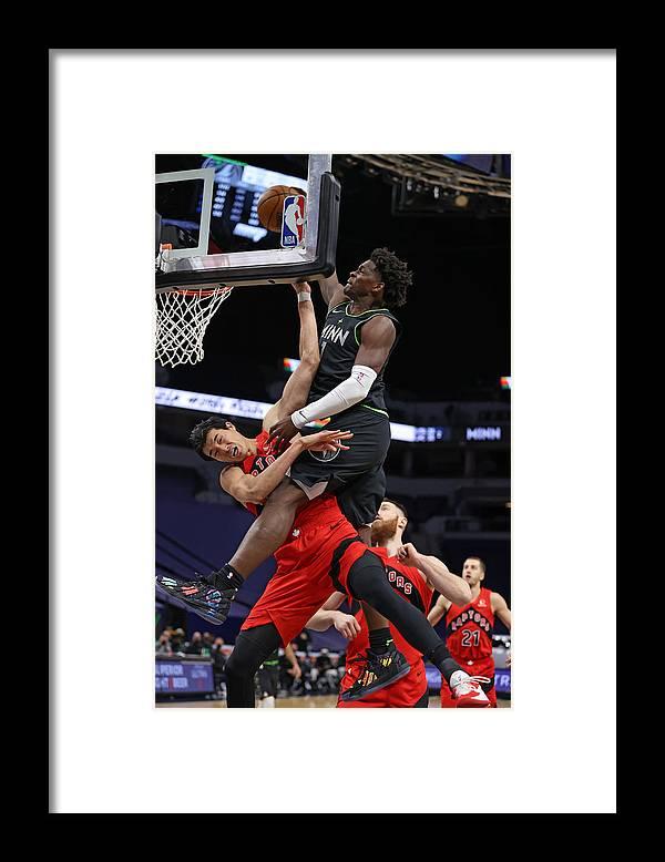 Nba Pro Basketball Framed Print featuring the photograph Toronto Raptors v Minnesota Timberwolves by Jordan Johnson