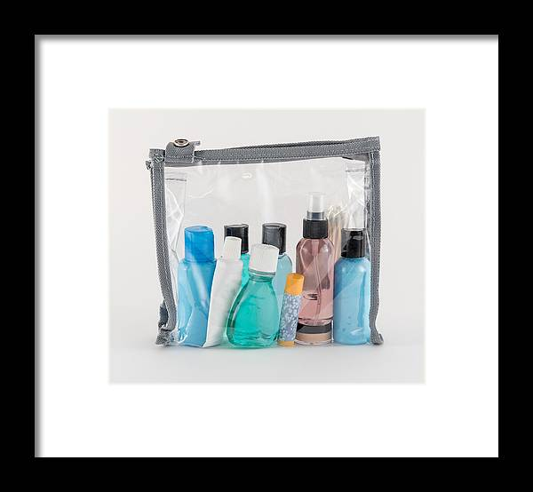 Cotton Swab Framed Print featuring the photograph Travel Toiletries in Clear Plastic Bag by Krisblackphotography