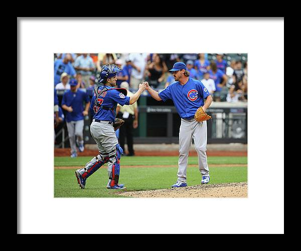 People Framed Print featuring the photograph Travis Wood and Miguel Montero by Al Bello
