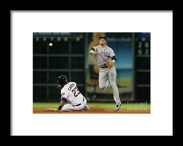 American League Baseball Framed Print featuring the photograph Troy Tulowitzki and Chris Carter by Scott Halleran