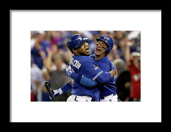 People Framed Print featuring the photograph Troy Tulowitzki and Edwin Encarnacion by Vaughn Ridley