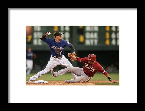 Double Play Framed Print featuring the photograph Troy Tulowitzki And Martin Prado by Dustin Bradford
