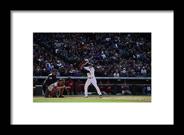 Baseball Catcher Framed Print featuring the photograph Troy Tulowitzki and Miguel Montero by Doug Pensinger