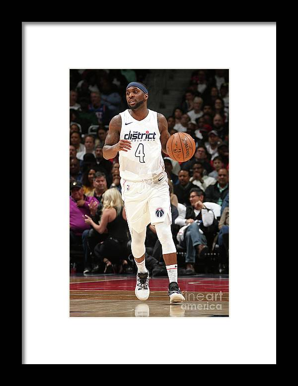 Playoffs Framed Print featuring the photograph Ty Lawson by Ned Dishman