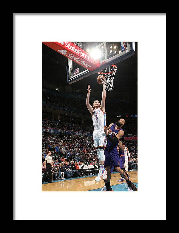 Nba Pro Basketball Framed Print featuring the photograph Tyson Chandler and Domantas Sabonis by Layne Murdoch