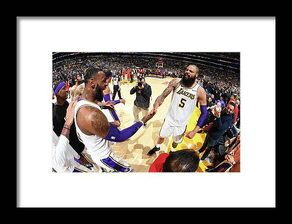 Nba Pro Basketball Framed Print featuring the photograph Tyson Chandler and Lebron James by Andrew D. Bernstein