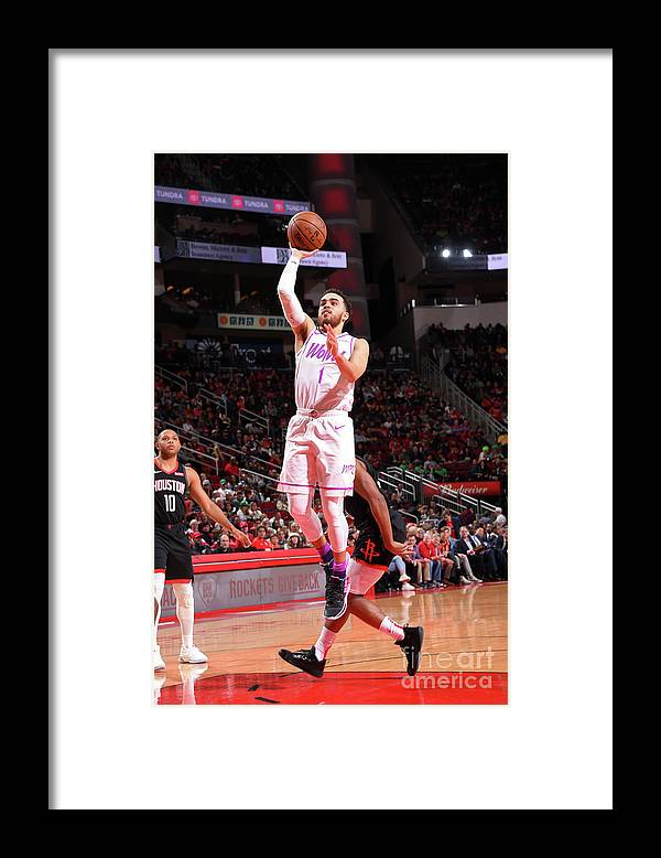 Nba Pro Basketball Framed Print featuring the photograph Tyus Jones by Bill Baptist