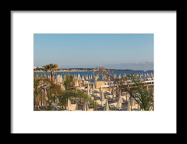 Chaise Longue Framed Print featuring the photograph Umbrellas and beach chairs on the beach, Cannes, French Riviera by Jean-Marc PAYET