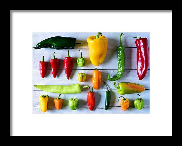 Orange Color Framed Print featuring the photograph Variety of fresh peppers by Photo by Cathy Scola