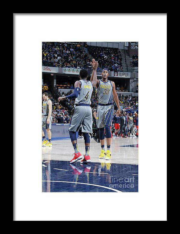 Nba Pro Basketball Framed Print featuring the photograph Victor Oladipo and Myles Turner by Ron Hoskins