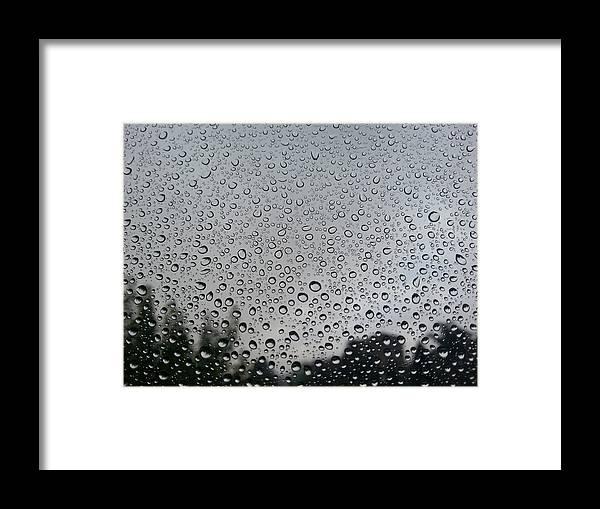 Treetop Framed Print featuring the photograph View Of Rain On Window Glass by Francesco Nacchia / EyeEm
