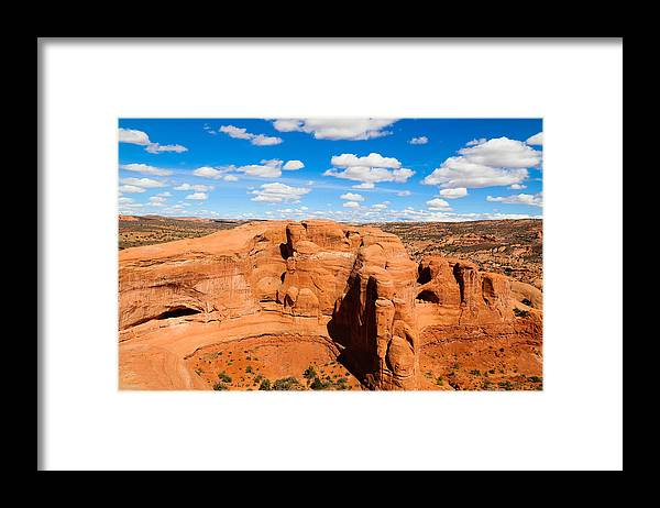 Tranquility Framed Print featuring the photograph View Of Rock Formations Against Cloudy Sky by Alberto Zanoni / EyeEm