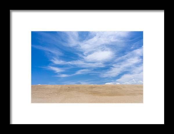 Tranquility Framed Print featuring the photograph View Of Sand Against Blue Sky And Clouds by Jesse Coleman / Eyeem