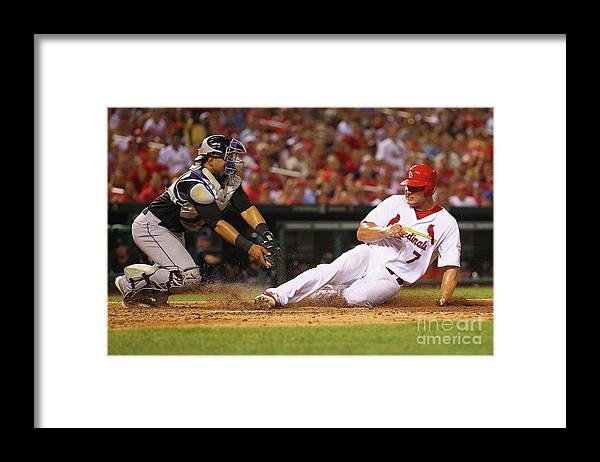 St. Louis Cardinals Framed Print featuring the photograph Wilin Rosario and Matt Holliday by Dilip Vishwanat