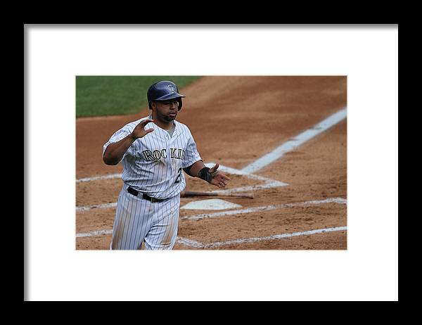 Second Inning Framed Print featuring the photograph Wilin Rosario by Doug Pensinger