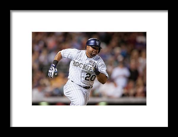 National League Baseball Framed Print featuring the photograph Wilin Rosario by Dustin Bradford