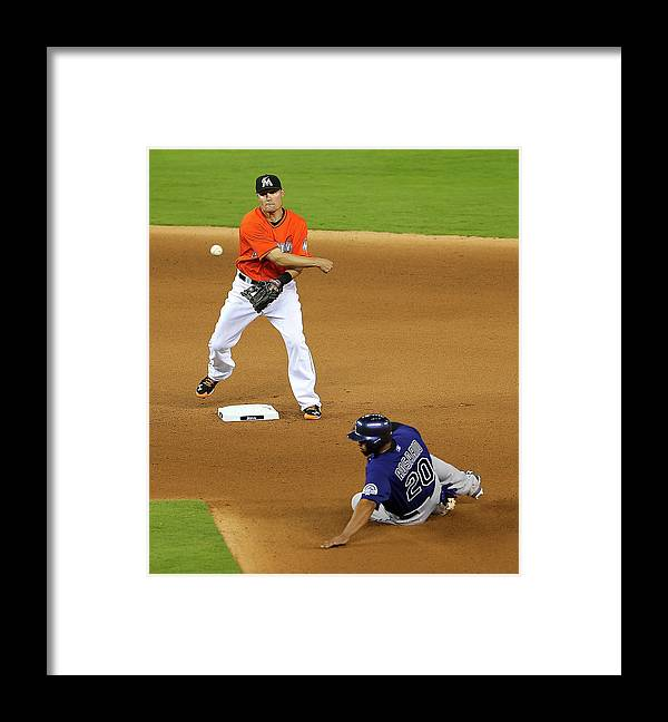Double Play Framed Print featuring the photograph Wilin Rosario by Mike Ehrmann