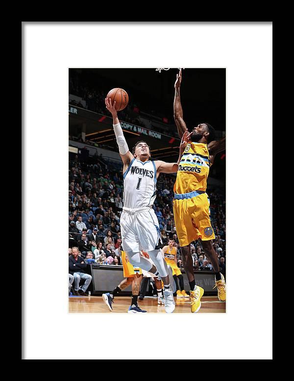 Nba Pro Basketball Framed Print featuring the photograph Will Barton and Tyus Jones by David Sherman