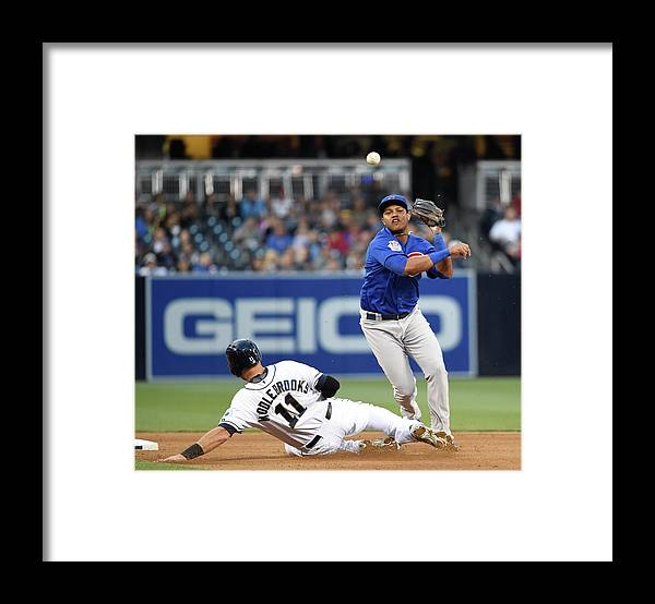 Double Play Framed Print featuring the photograph Will Middlebrooks and Starlin Castro by Denis Poroy
