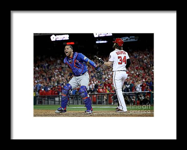 American League Baseball Framed Print featuring the photograph Willson Contreras and Bryce Harper by Win Mcnamee
